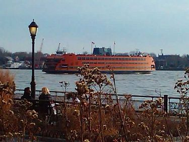 The Staten Island Ferry, seen from the Battery, crosses Upper New York Bay, providing free public transportation between Staten Island and Manhattan. Staten Island Ferry-Battery Park-2012.jpg