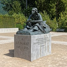 Outdoor statue of a seated Jean-Paul Marat