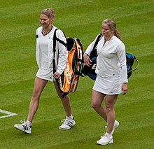 Clijsters walking onto Wimbledon Centre Court with Steffi Graf.