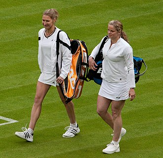 Kim Clijsters - Clijsters (right) with her idol Steffi Graf in 2009. Graf won their only meeting on the WTA Tour in 1999.