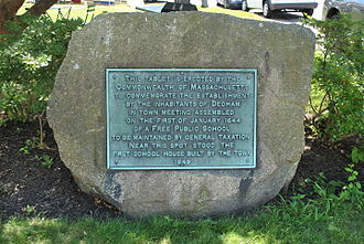Stone plaque marking the site of the first public school in America in Dedham, Massachusetts Stone plaque marking the site of the first public school in America.JPG