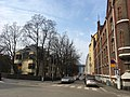 Street with houses and apartments (30632705347).jpg