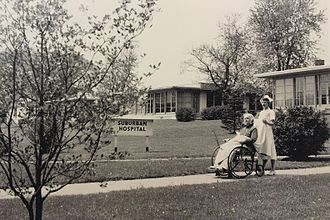 Suburban Hospital - A nurse with her patient at the original Suburban Hospital in 1943