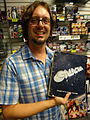 Syfy Collection Intervention - Battlestar Galactica - Mike Wellman with Richard Hatch's original Battlestar Galactica script. (14155243951).jpg