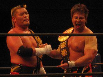 Hiroyoshi Tenzan - Tenzan (left) and Satoshi Kojima as the IWGP Tag Team Champions in February 2012.