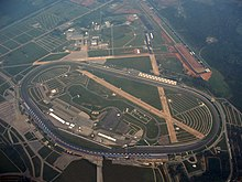Talladega Superspeedway aerial view; the track was built on the site of an old airport, with two runways still visible