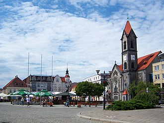 Tarnowskie Góry - The market square (Rynek) in Tarnowskie Góry with the Neo-Romanesque Protestant church on the right side