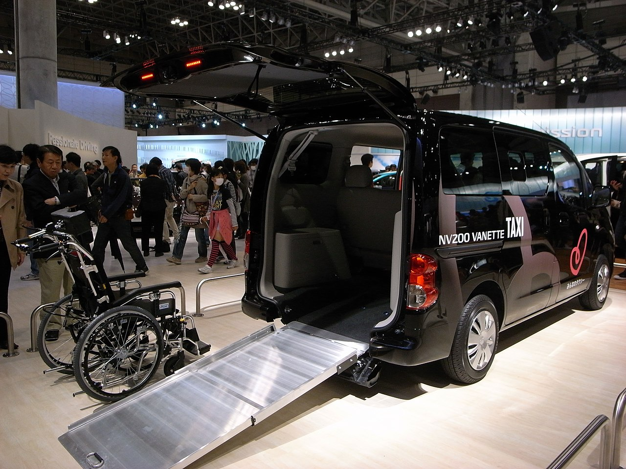 A wheelchair accessible taxi with a rear ramp