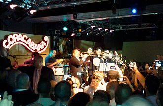 A photograph of Willie Colón performing opening night at the new Copacabana.