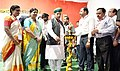The Minister of State for Finance and Corporate Affairs, Shri Arjun Ram Meghwal lighting the lamp to inaugurate DigiDhan Mela, in Nizamabad, Telangana.jpg