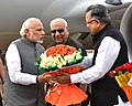 The Prime Minister, Shri Narendra Modi being received by the Governor of Chhattisgarh, Shri Balramji Das Tandon and the Chief Minister of Chhattisgarh, Dr. Raman Singh, on his arrival at Raipur, in Chhattisgarh.jpg