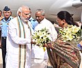 The Prime Minister, Shri Narendra Modi being welcomed by the Governor of Rajasthan, Shri Kalyan Singh and the Chief Minister of Rajasthan, Smt. Vasundhara Raje Scindia, on his arrival, at Jaisalmer Air base, in Rajasthan.jpg