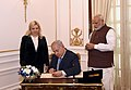 The Prime Minister of Israel, Mr. Benjamin Netanyahu signing the visitors' book, at Hyderabad House, in New Delhi on January 15, 2018. The Prime Minister, Shri Narendra Modi is also seen.jpg