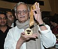 The veteran film lyricist, director, screen writer, producer and poet, Shri Gulzar with the Dadasaheb Phalke Award 2013, presented by the President, Shri Pranab Mukherjee, at the 61st National Film Awards function.jpg