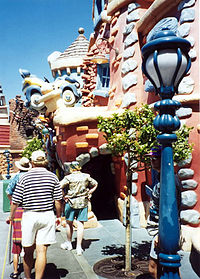 Toontown buildings and fixtures are composed of shapes and colors that one might see in a cartoon.