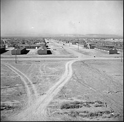 Topaz, Utah. Looking down a main thoroughfare at the Topaz Relocation Center. - NARA - 538677.jpg