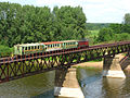 Train narrow-gauge railway on the bridge over the river Cheptsa.jpg