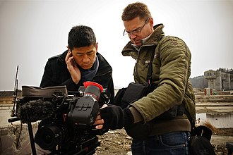 Steve Chao - Senior Asia Correspondent, Steve Chao (left) and senior cameraperson Matthew Allard look over video in the ruins of Otsuchi, Japan.