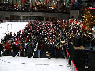 Tubachristmas created in 1974 by tubist Harvey Phillips to honor his teacher, mentor, is a music concert in cities worldwide that celebrates those who play, teach, and compose music for instruments in the tuba family.  Instruments in the tuba family that often appear are the tuba, Sousaphone, baritone, and euphonium