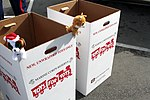 """Two stuffed childrens toys """"stand guard"""" of Toys for Tots boxes during a toy drive at the USS Midway in San Diego, Calif., Dec. 1, 2012 121201-M-OB827-007.jpg"""
