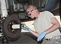 U.S. Air Force Airman 1st Class Taylor Wheless, a student assigned to the 362nd Training Squadron, applies grease to the axle of a C-130 Hercules aircraft June 16, 2011, at Sheppard Air Force Base, Texas 110616-F-NS900-008.jpg