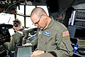 U.S. Air Force Tech. Sgt. Nathan Dennis, center, a flight engineer with the 156th Airlift Squadron, North Carolina Air National Guard, goes over a preflight checklist on a C-130 Hercules aircraft attached to 130507-Z-AW931-424.jpg