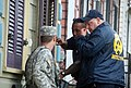 U.S. Army Spc. Peter H. Breslin, left, with the 1st Battalion, 141st Field Artillery Regiment, Louisiana Army National Guard, prepares to back up New Orleans Police Department officers as they search a home that 120828-A-SM895-004.jpg