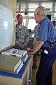 U.S. Army Warrant Officer 1 Jacob Grobler, left, speaks with journalist David C. Henley on board Landing Craft Utility 2032 in Port Hueneme, Calif., March 22, 2013 130322-A-IO170-035.jpg