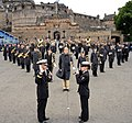 U.S. Naval Forces Europe Band Director Lt. David Latour, left, gives the oath of re-enlistment to Musician 3rd Class Margaret Pedlow after the band rehearsed their segment of the Royal Edinburgh Military Tattoo 120731-N-VT117-1545.jpg