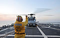 U.S. Navy Boatswain's Mate 2nd Class Tarick Birttingham directs an SH-60B Seahawk helicopter, assigned to Helicopter Anti-Submarine Squadron Light (HSL) 51, on the flight deck of the guided missile destroyer USS 130315-N-BX824-174.jpg