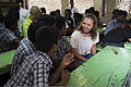 U.S. Navy Boatswain's Mate 3rd Class Ashley Smith, right, assigned to the guided missile destroyer USS McCampbell (DDG 85), talks with students during a community service project in Chennai, India, Nov. 5 131105-N-TX154-427.jpg