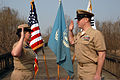 "U.S. Navy Capt. Deidre McLay, chief of staff for Commander, U.S. Naval Forces Korea, re-enlists Chief Personnel Specialist Brian Robinson on the ""Bridge of No Return"" at the demilitarized zone between 090401-N-AT279-004.jpg"