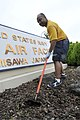 U.S. Navy Information Systems Technician 1st Class Lydale Hyde helps remove weeds during a command beautification day aboard Naval Air Facility Misawa, Japan, Aug. 10, 2012 120810-N-VZ328-022.jpg