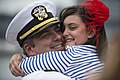 U.S. Navy Lt. Cmdr. Kirk Ochalek, left, the chief staff officer for Pacific Partnership 2013 and assigned to the amphibious dock landing ship USS Pearl Harbor (LSD 52), hugs his daughter in San Diego after 130826-N-ZU025-140.jpg
