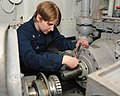 U.S. Navy Machinist's Mate 3rd Class Rebecca V. Neal tightens a bolt on a mechanical seal for an aircraft elevator aboard the aircraft carrier USS Nimitz (CVN 68) 130123-N-BJ752-006.jpg