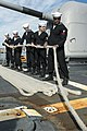 U.S. Sailors handle mooring line aboard the guided missile cruiser USS Philippine Sea (CG 58) as the ship pulls into Piraeus, Greece, for a scheduled liberty port visit March 4, 2014 140304-N-PJ969-360.jpg
