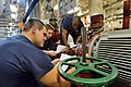 U.S. Sailors review instructions before performing maintenance on a fire pump aboard the guided missile destroyer USS Ross (DDG 71) Aug. 25, 2014, at Naval Support Activity Souda Bay, Greece 140825-N-IY142-026.jpg