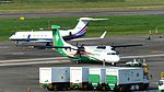 UNI Air ATR 72-600 B-17011 Backing by Tractor in Taipei Songshan Airport 20160821.jpg
