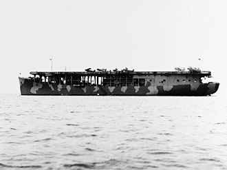 USS Long Island (CVE-1) - Long Island in sea camouflage, November 1941. Seven SOC Seagull floatplanes and one F2A3 Buffalo fighter are on deck.