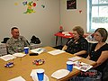US Army 51071 Lt. Col. Gerald Boston, commander of the 2nd Battalion, 7th Cavalry Regiment, 4th Brigade Combat Team, 1st Cavalry Division meets with Venable Village principal Cynthia Potvin to discuss upcoming even.jpg