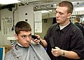 US Navy 030312-N-4965F-505 Ship's Serviceman Seaman Tad White from Belfast, N.Y., provides haircuts for crew members aboard USS Theodore Roosevelt (CVN 71).jpg