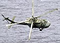 US Navy 030520-N-0295M-013 An SH-60F Seahawk banks sharply towards Constellation to demonstrate it's ability to fly very low to the water.jpg
