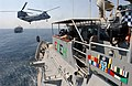 US Navy 030627-N-6077T-001 A CH-46 Sea Knight helicopter attached to the fast combat support ship USS Bridge (AOE 10), transfers supplies to the guided missile cruiser USS Chosin (CG 65) during a vertical replenishment, (VERTRE.jpg