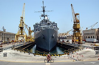 Cospicua - A Maltese shipyard worker heads home on his bicycle after a day's work on USS La Salle in Cospicua.