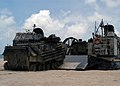 US Navy 040609-N-1512S-072 Marines assigned to the 24th Marine Expeditionary Unit (24th MEU) load Landing Assault Vehicles (LAV's) onto a Landing Craft, Air Cushion (LCAC).jpg