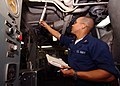 US Navy 040701-N-4374S-003 Engineman 3rd Class Carlos Martinez checks the temperature in main engine room two.jpg