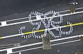 US Navy 040723-N-7615S-148 Sailors wearing summer white dress uniforms assemble on the ship's flight deck aboard USS Ronald Reagan (CVN 76) to form the ship's double-R log honoring the former President Ronald Reagan.jpg