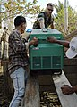 US Navy 050106-N-9951E-009 Ens. Jason Lofton, of Corcoran, Calif., helps two Indonesian nationals unload a portable generator at the local hospital in Aceh, Sumatra, Indonesia.jpg