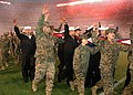 US Navy 050109-N-1722M-008 Sailors and Marines wave to the sold-out Qualcomm Stadium as they take a reproduction Continental U.S. shaped flag out of the stadium after waving it for the national anthem prior to the San Diego Cha.jpg