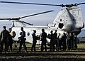 US Navy 050115-N-8539M-003 U.S. Navy and U.S. Marine Corps personnel from a working party while loading food into a waiting CH-46 Sea Knight helicopter belonging to Marine Medium Helicopter Squadron 262 (HMM-262) at the Sultan.jpg